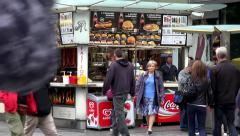 City - street fast food stall - people eat - people walking Stock Footage