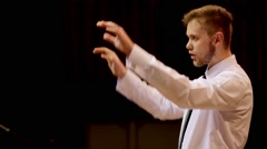 Choir conductor during performance Stock Footage