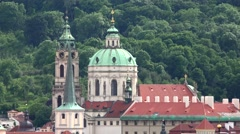 Prague - church - roof of buildings - trees in background Stock Footage