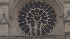 Stock Video Footage of Detail of world famous Notre Dame church french architecture in Paris, landmark