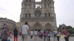 Stock Video Footage of Famous Notre Dame cathedral in Paris France toursits visiting religious landmark