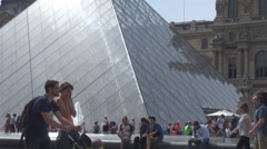 Travelers in Paris at Louvre museum glass pyramid, french culture pride, famous - stock footage