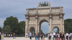 Summer season in romantic Paris, tourist at arc de triomphe du carrousel, gate Stock Footage