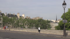 Bridge over Seine downtown Paris, Pont Marie, parisian people, tourists, cars Stock Footage