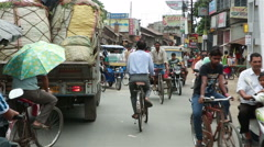Crazy traffic in India. Many pedestrians, cars, trucks, rickshaws, motorcycles. - stock footage