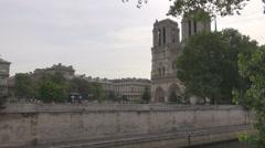 Ile de la Cite Paris, Seine river, side view of Notre Dame green trees in summer Stock Footage