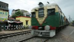 Crowded Passenger train moving in western India. - stock footage
