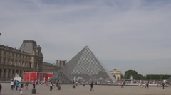 Louvre museum pyramid and tourists around, french culture pride, Paris landmark - stock footage