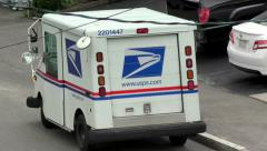 Post office mail truck drives down street, sound Stock Footage