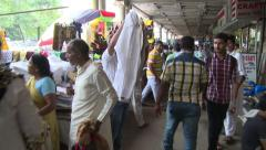 Lots of street vendors and shoppers on market street in Kolkata, India. Stock Footage