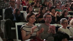 Fans of classical music applaud the artists in the concert hall. Stock Footage