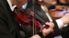 Group of violinists in a Symphony orchestra. - stock footage