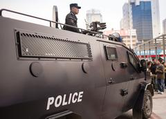 Armored police truck in the city Stock Photos