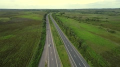 Stock Video Footage of Areal view over beautiful evergreen road