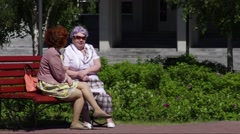 Surgut, City Council building. People talk on the bench Stock Footage