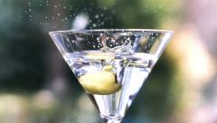 Martini With Olive Splashing In Slow Motion Stock Footage