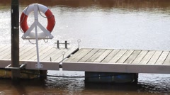 Boat Dock with lifebuoy Stock Footage