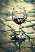 Red wine poured in goblet - stock photo