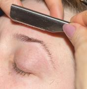 Grooming eyebrows in a beauty salon Stock Photos