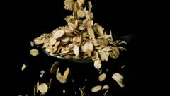 Oatmeal Falls on Spoon Slow Motion - stock footage