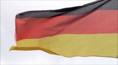 Germany flag in the wind, backgound sky, copy space Stock Footage