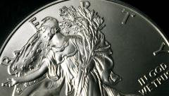 US Silver Eagle Liberty Face Coin Slow Motion Bounce Stock Footage