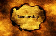 Stock Photo of Leadership text on burning paper hole