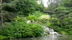 Waterfall going into lake in a Japanese Garden Stock Footage