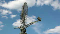 The antenna of the radar on the background of blue sky with white clouds Stock Footage