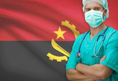 Surgeon with flag on background - Angola Stock Photos