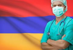 Surgeon with flag on background - Armenia Stock Photos