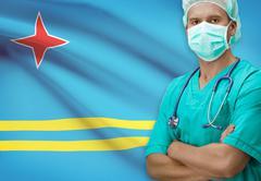 Surgeon with flag on background - Aruba - stock photo
