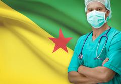 Surgeon with flag on background - French Guiana - stock photo