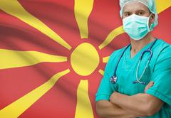 Stock Photo of Surgeon with flag on background - Macedonia