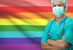 Surgeon with flag on background - LGBT people - stock photo