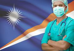 Surgeon with flag on background - Marshall Islands - stock photo