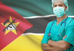 Stock Photo of Surgeon with flag on background - Mozambique