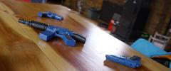Toy guns on a table - stock footage