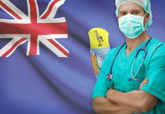 Surgeon with flag on background - Saint Helena - stock photo