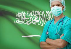 Surgeon with flag on background - Saudi Arabia - stock photo