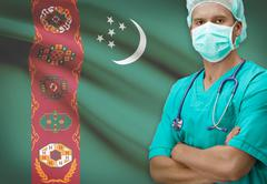 Surgeon with flag on background - Turkmenistan - stock photo