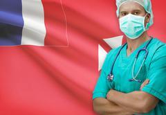 Surgeon with flag on background - Wallis and Futuna - stock photo