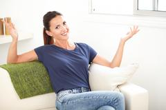 Three quarter length portrait of a cheerful woman smiling with her hands rais - stock photo