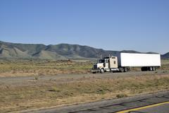 Trucks on interstate. - stock photo