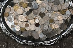 Old silver coins pile at flea market - stock photo