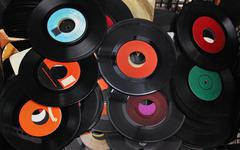 Pile of old used vinyl records sold on vintage market Stock Photos