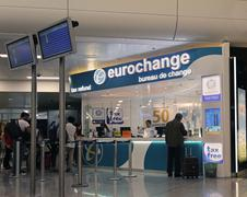 Tax refund and currency exchange counter at Athens airport and people waiting Stock Photos