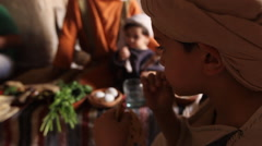 Young Boy Eating at Dinner, Biblical Re-enactment - stock footage