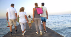 Big family with shopping bags on pier in the sea Stock Footage