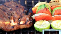 BBQ time barbecue with meat and vegetables Stock Footage